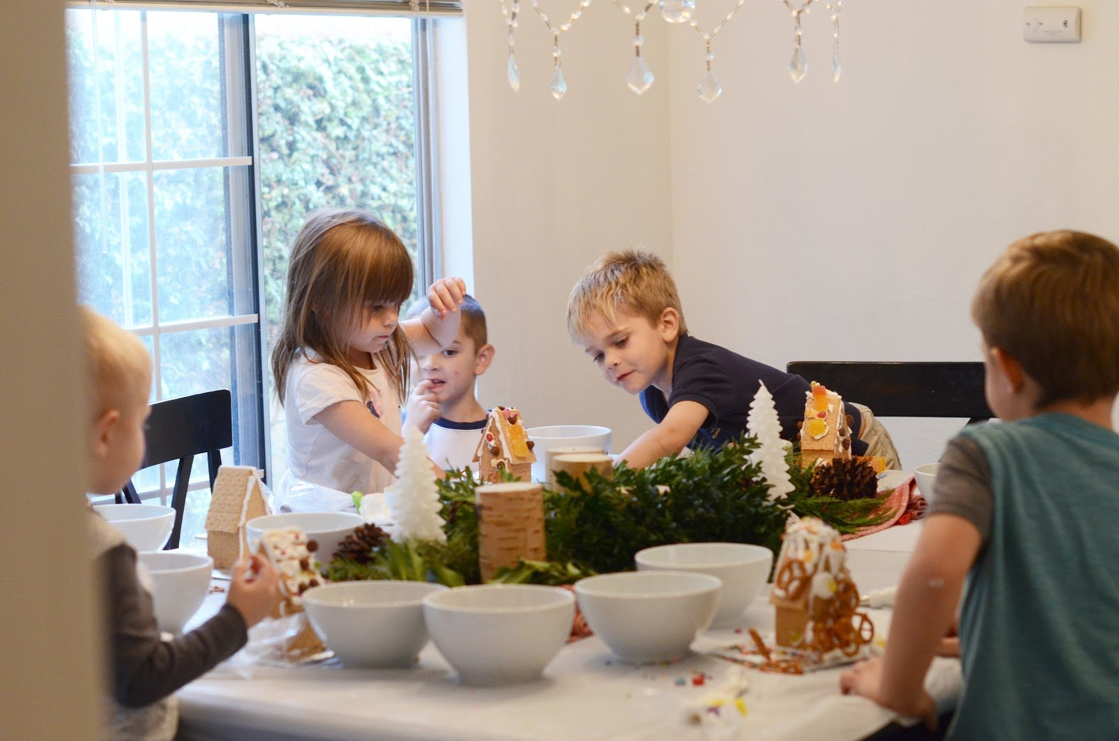 kids building gingerbread houses