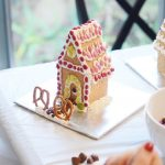 graham cracker gingerbread house on foil tray
