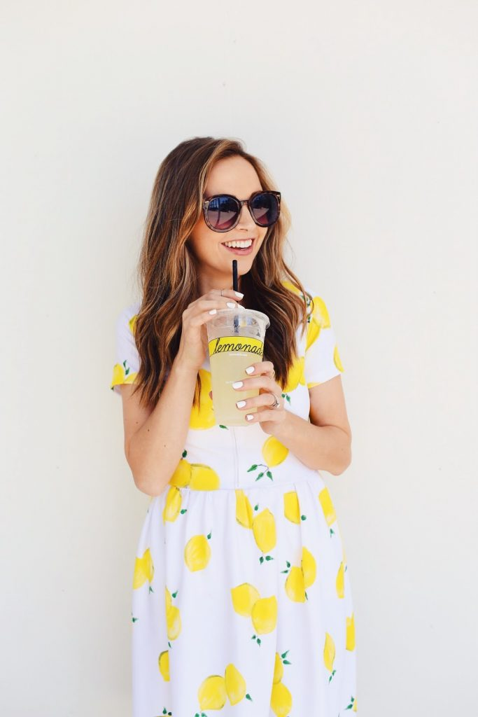 Learn how to sew this fit and flare gathered dress with sleeves and a lemon print fabric