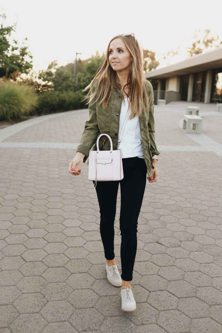 black jeans, olive jacket, lace up shoes