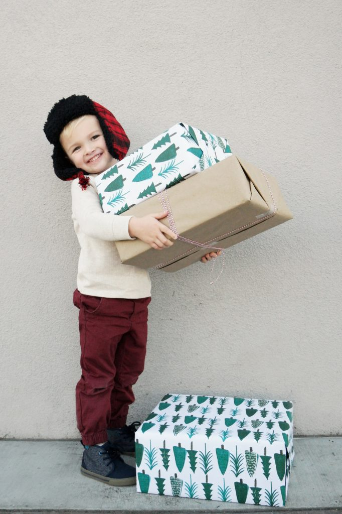 boy with wrapped christmas presents