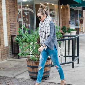 gray sweater, blue jeans, and blanket scarf