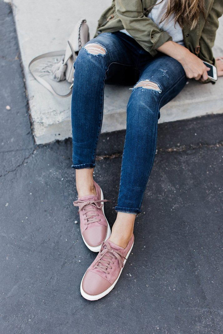 pink sneakers and jeans