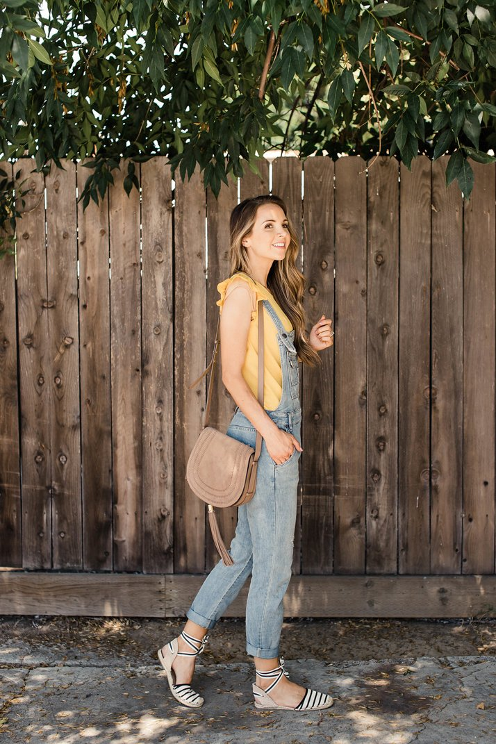 overalls with yellow blouse