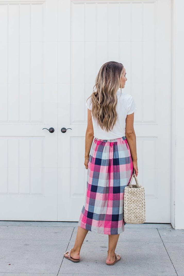 a plain white tee with a midi skirt