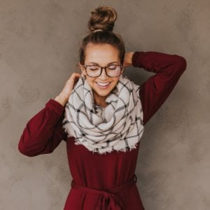 top knot with glasses and oversized scarf