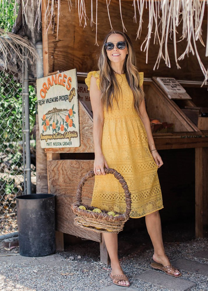 merricksart.com | grabbing some fresh fruit in my yellow lace dress from amazon fashion