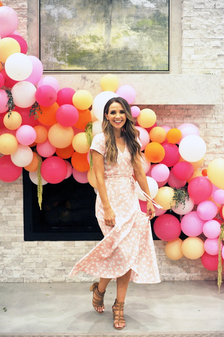 merricksart wrap dress and balloon arch