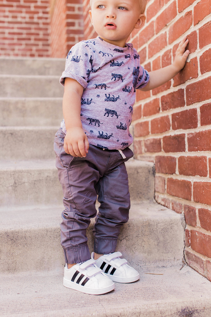 Little boy in adidas velcro sneakers from rack room shoes