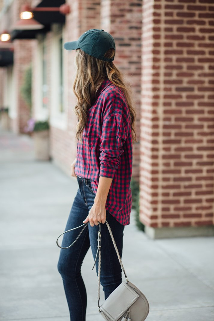An easy half tucked plaid shirt creates an effortless look