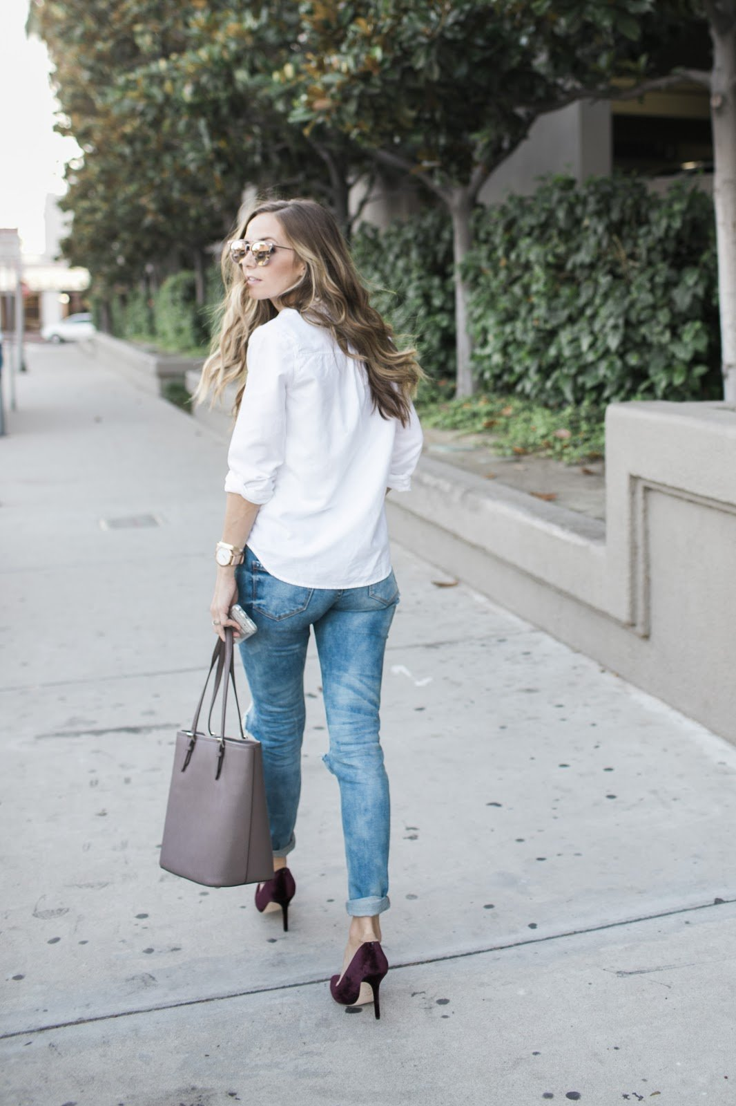 pair your boyfriend jeans with some lux pieces like a crisp white shirt and velvet pumps