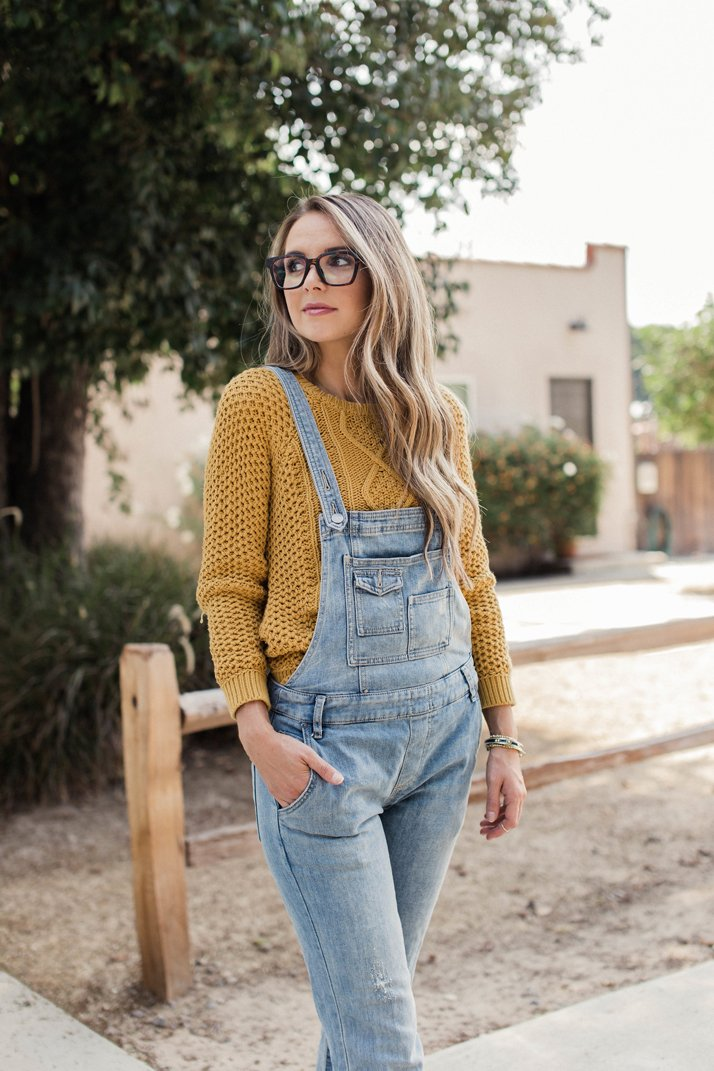 pair your overalls with a thick, cozy sweater for fall