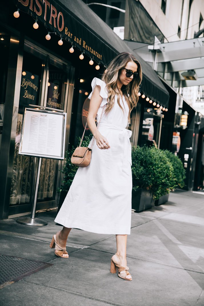 stepping out of the bistro in this crisp white linen dress