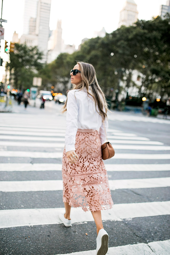 an easy skirt and sneaker look for nyfw