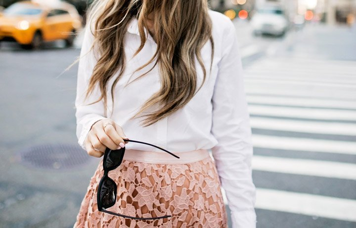 a feminine outfit with edgy sunglasses