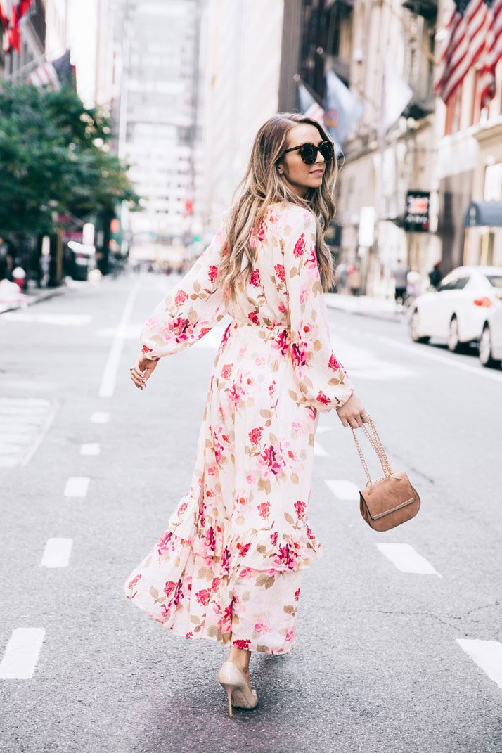 running down the streets of new york city in a floral maxi dress
