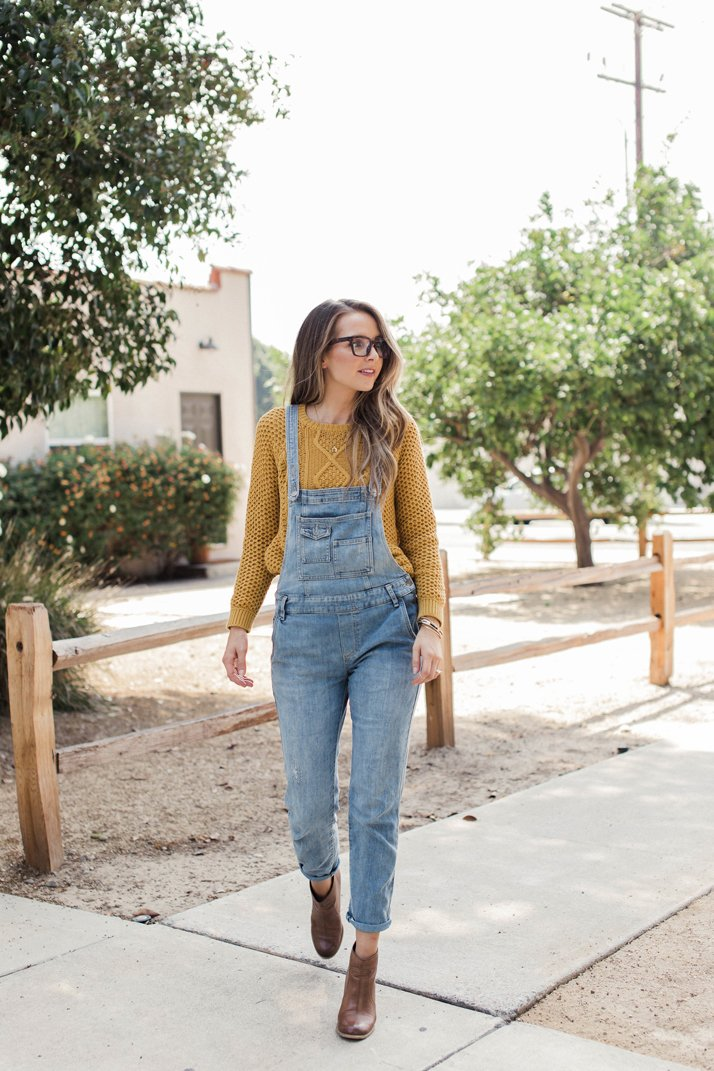 free people overalls with ankle boots and a mustard sweater