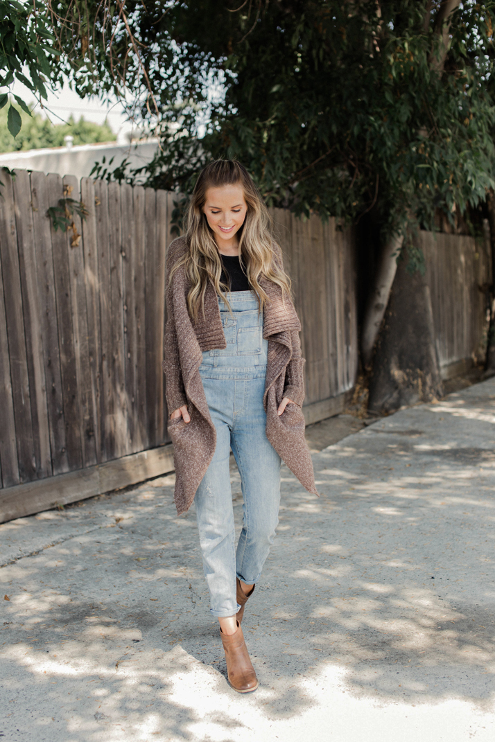 Try your overalls with a warm, cozy cardigan sweater for fall