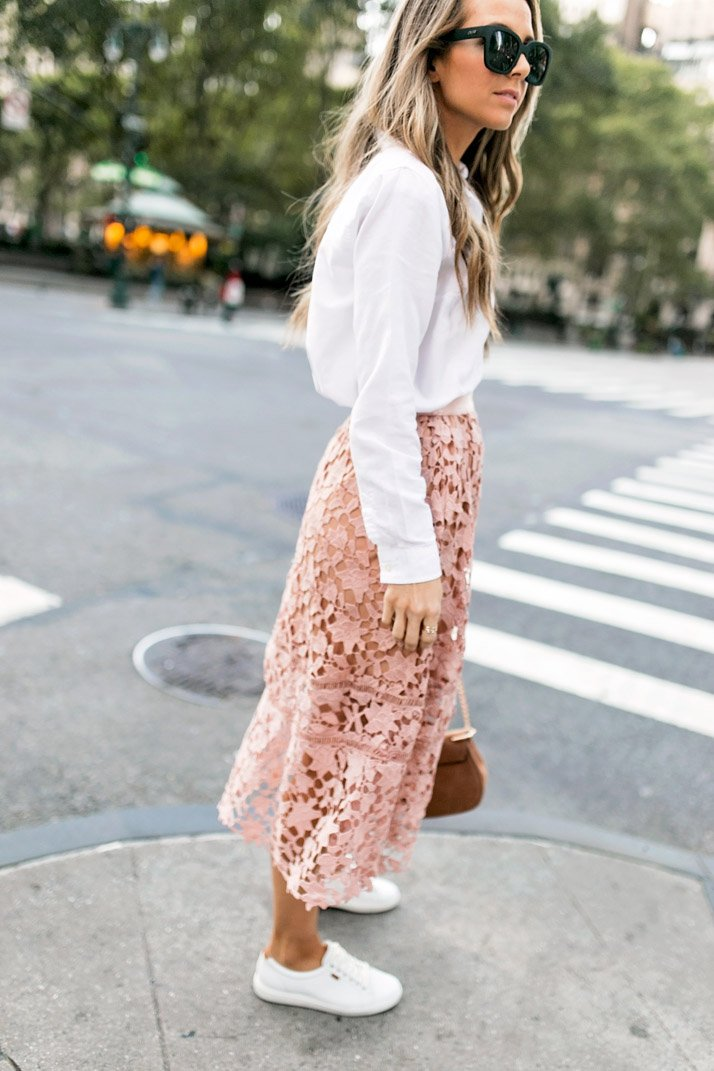 a pink lace skirt and white button down blouse with ecco sneakers