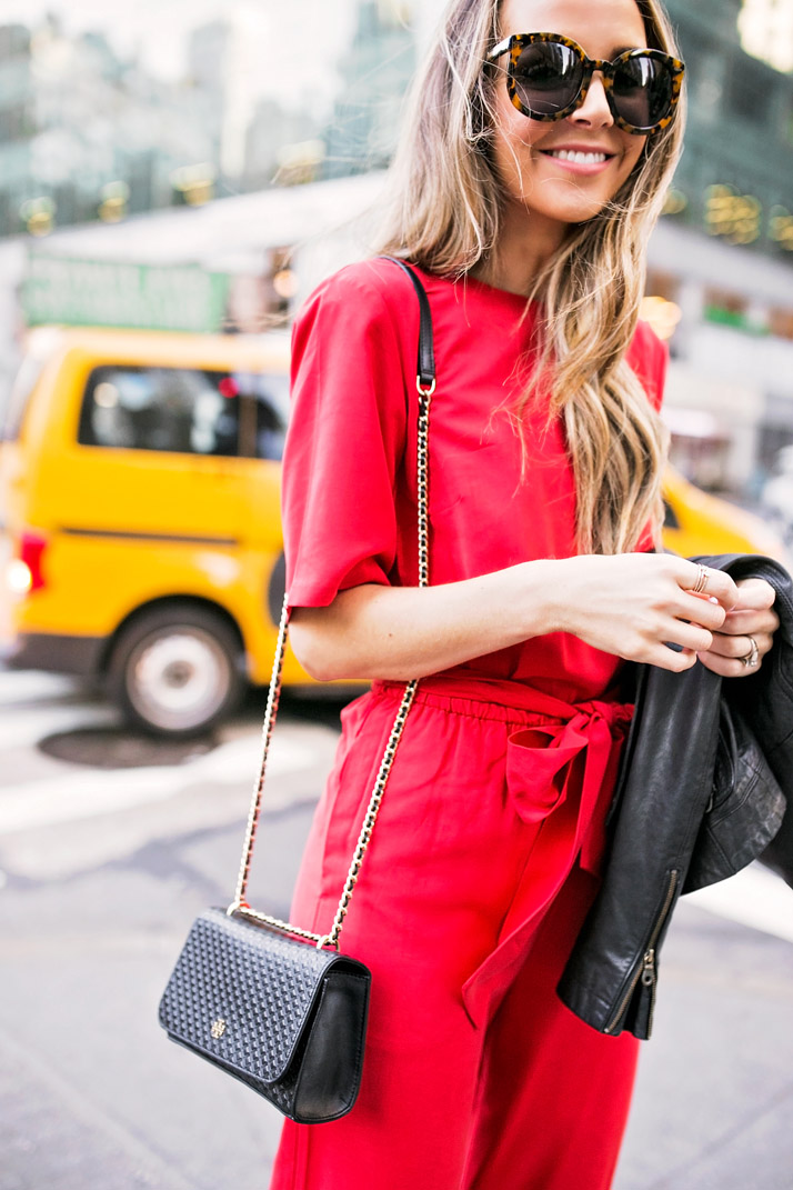 a bold red jumpsuit makes such a perfect holiday statement
