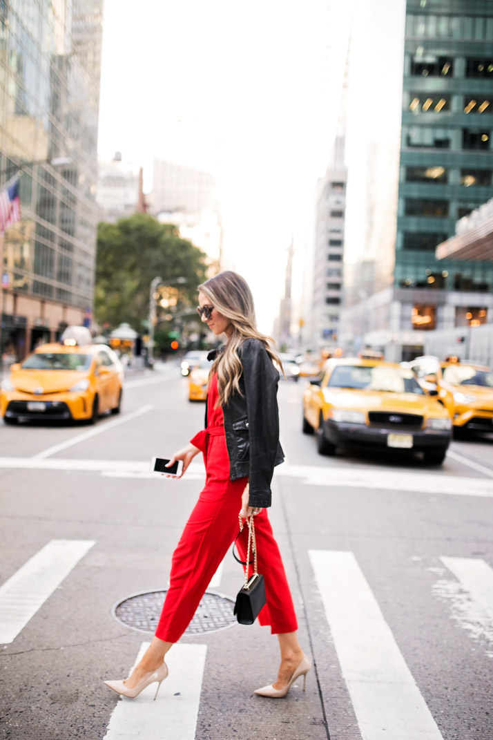 a new york moment in a fabulous bright red jumpsuit