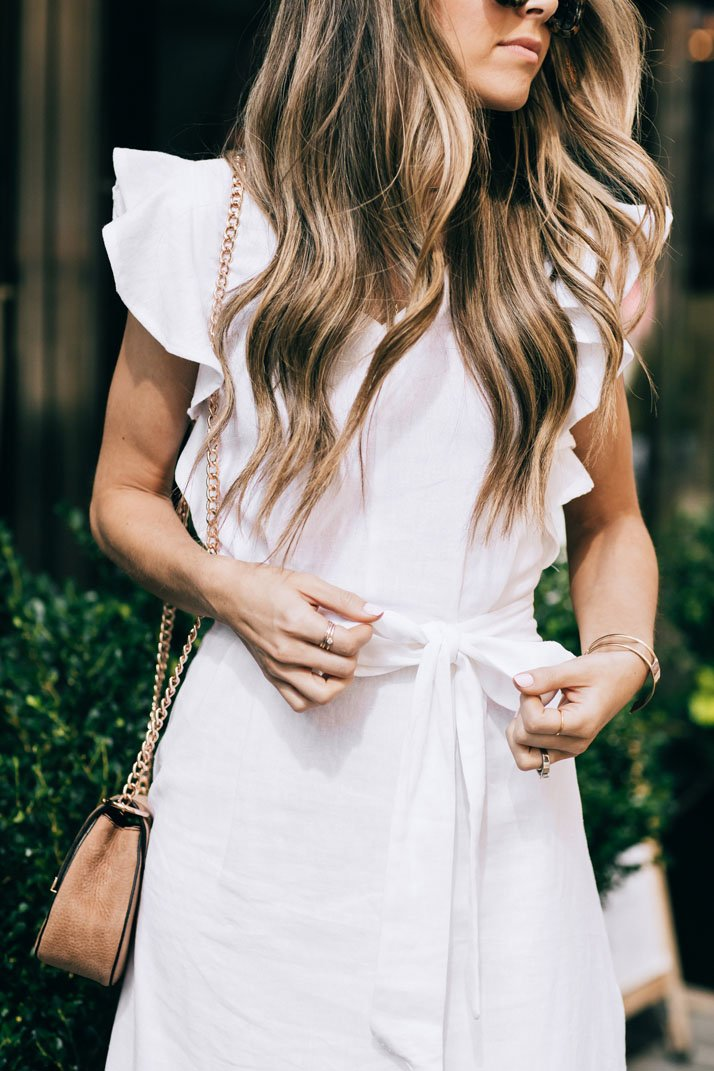 little details like a bow tie waist and ruffle sleeves make this white linen dress so special