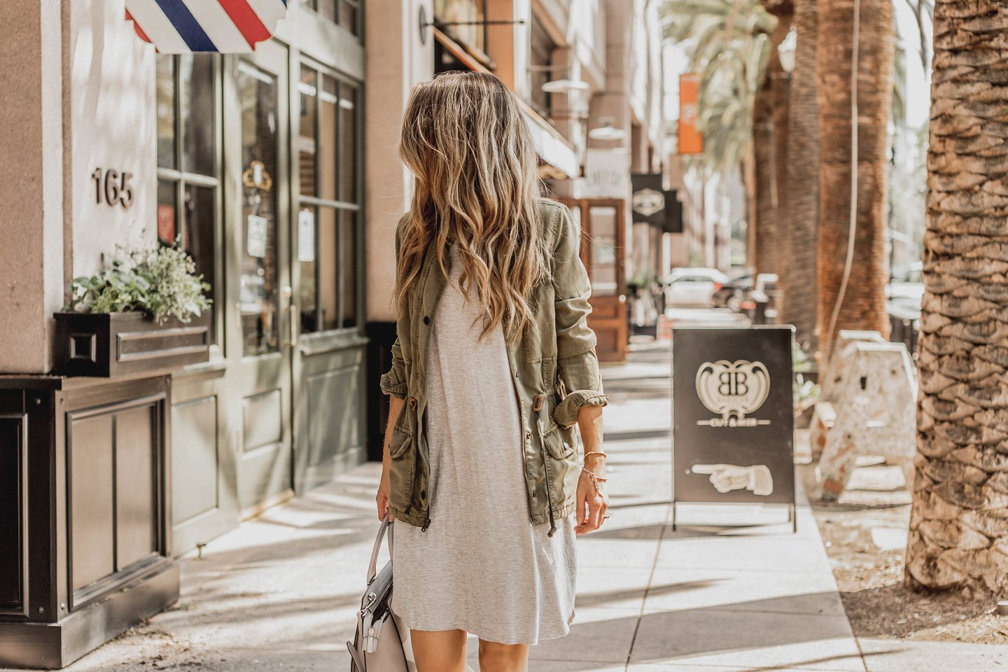 an easy gray t-shirt dress with an olive jacket