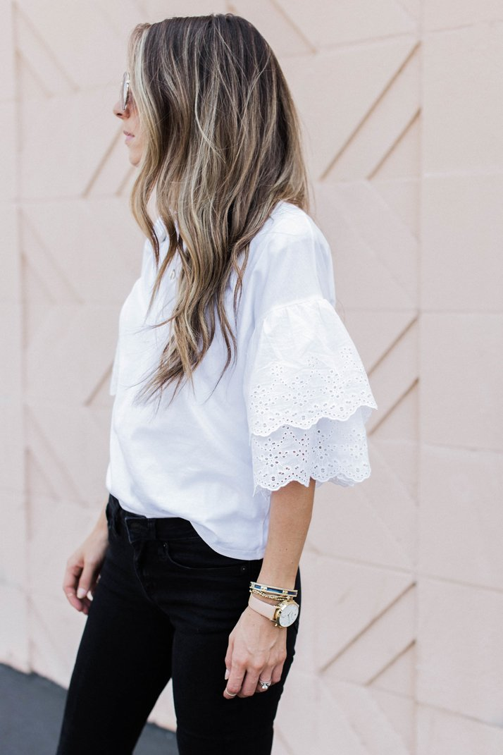 an eyelet lace ruffle sleeve top makes a feminine fashion statement