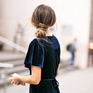 an easy low messy bun is perfect with a fancy dress