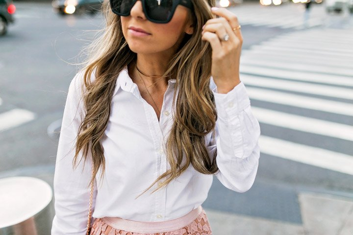 all black sunglasses add a little edge to a feminine outfit