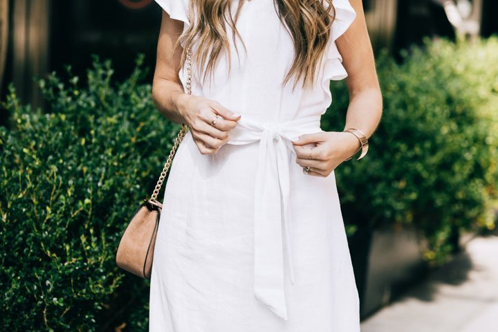 bow details on this white linen midi dress