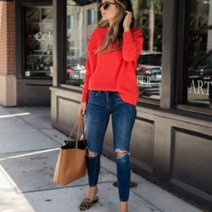 a bold red sweater and leopard loafer mules