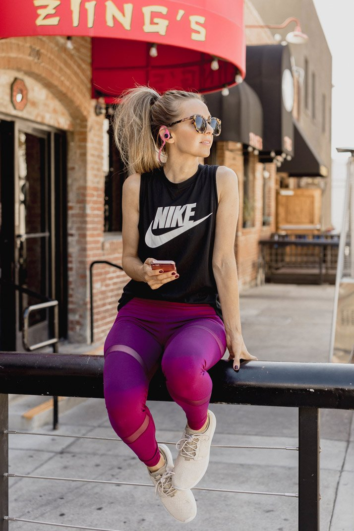nike tank with old navy leggings and earbuds