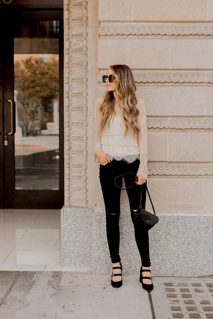 black jeans and a lace top make a perfect casual holiday look