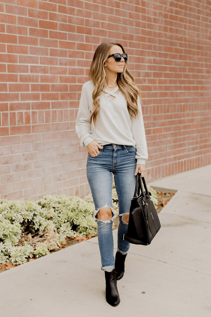 black ankle boots and a sweatshirt