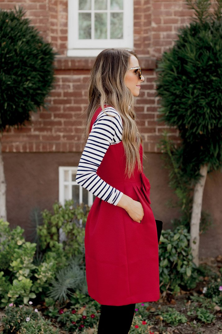 this bold red dress has pockets!
