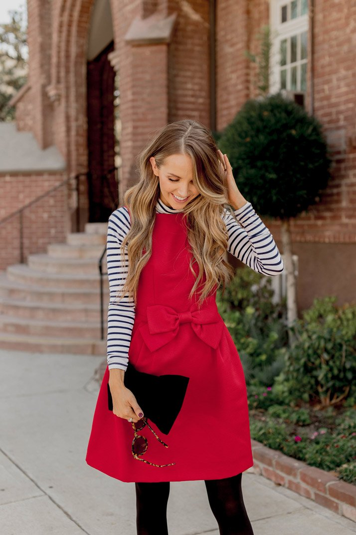 a bright red dress is a fun way to boost your holiday look!