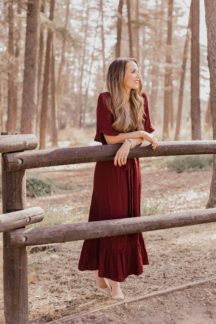 burgundy midi dress with a ruffle
