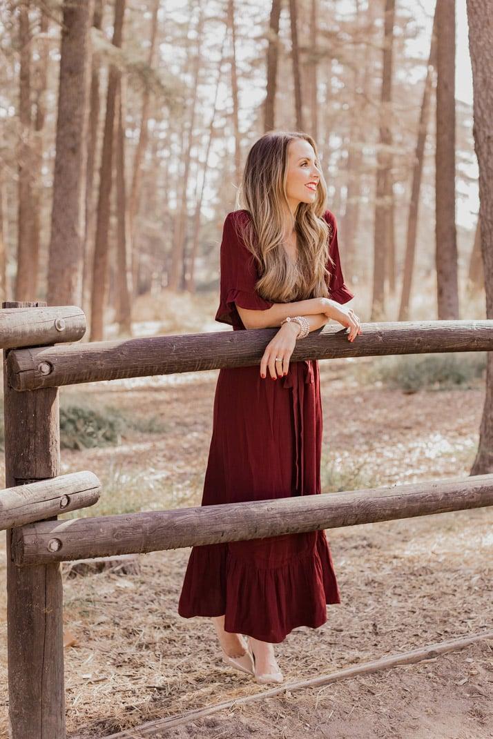 burgundy midi dress with a ruffle