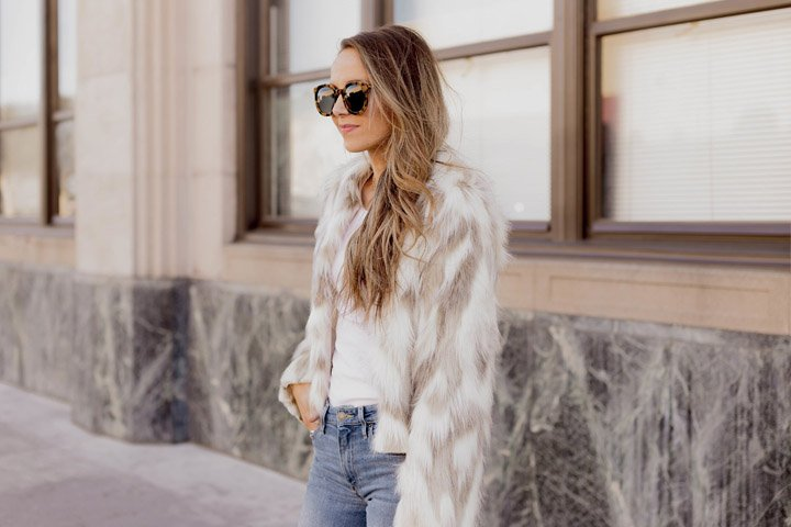 faux fur jacket and blue jeans