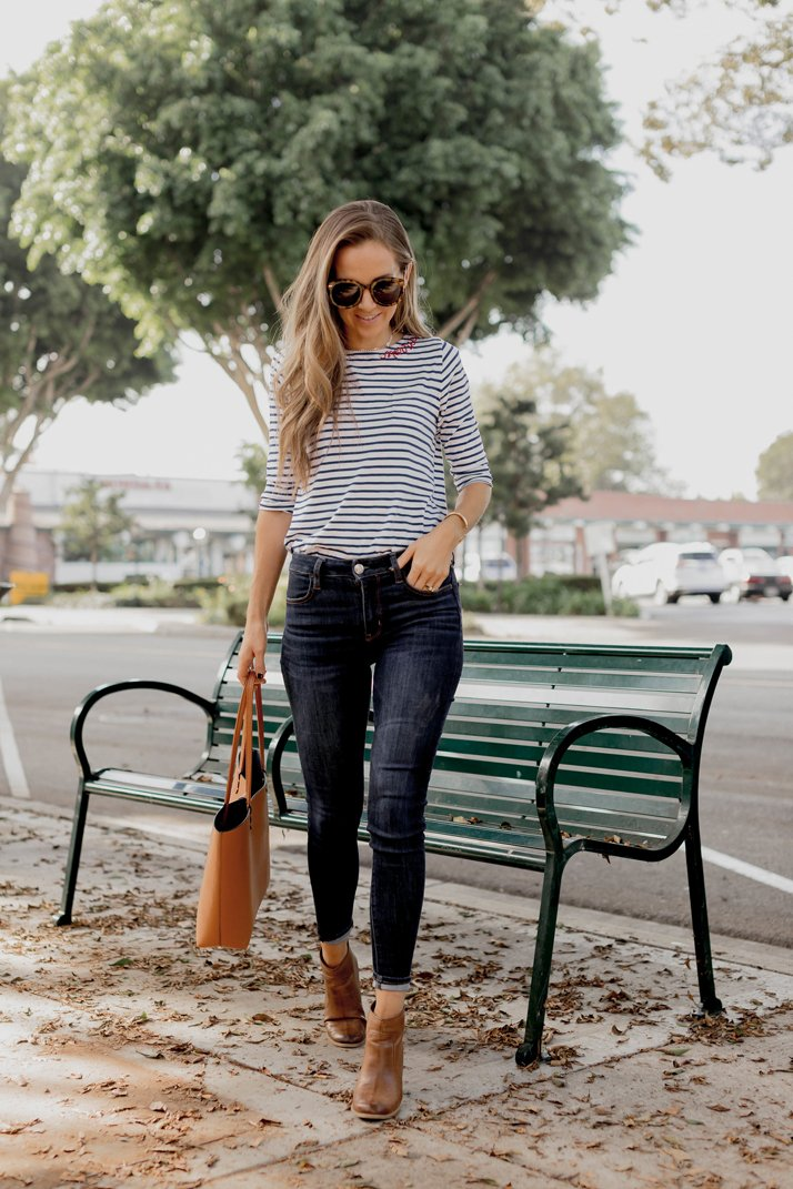 striped tee and dark jeans