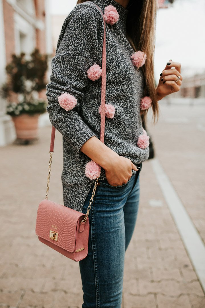 turn an ordinary sweater into a cute pom pom sweater!
