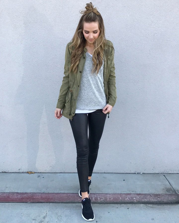 leather leggings and an olive jacket