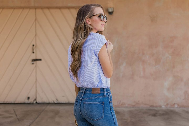 fully tuck your shirt into mid or high rise jeans to accentuate your waist