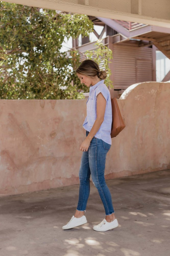 White sneakers with jeans and blue pinstripe top