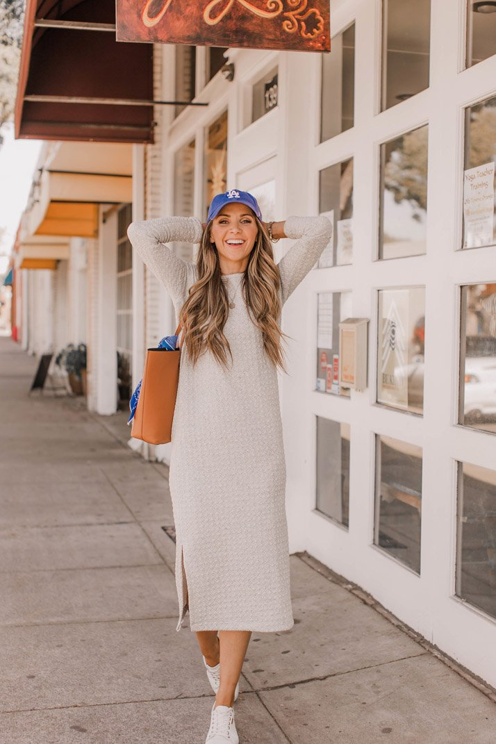 a midi dress and a pair of simple sneakers makes a great weekend outfit