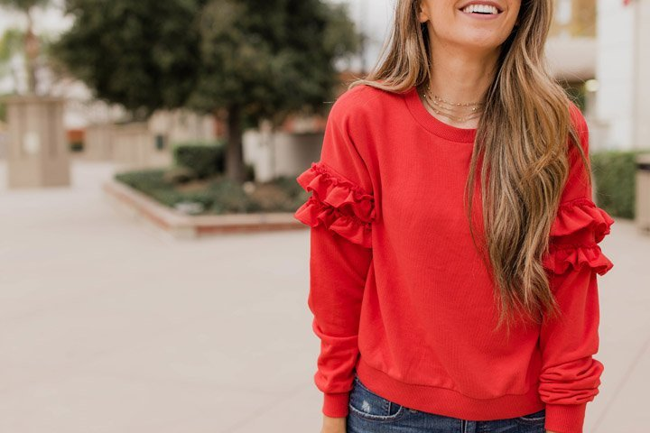 red ruffle sleeve sweatshirt