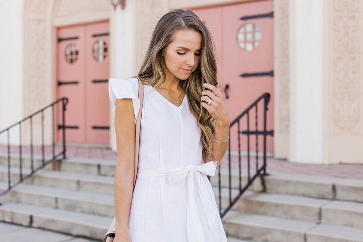 a white linen dress is perfectly complimented by soft blue jewelry from Shane Co