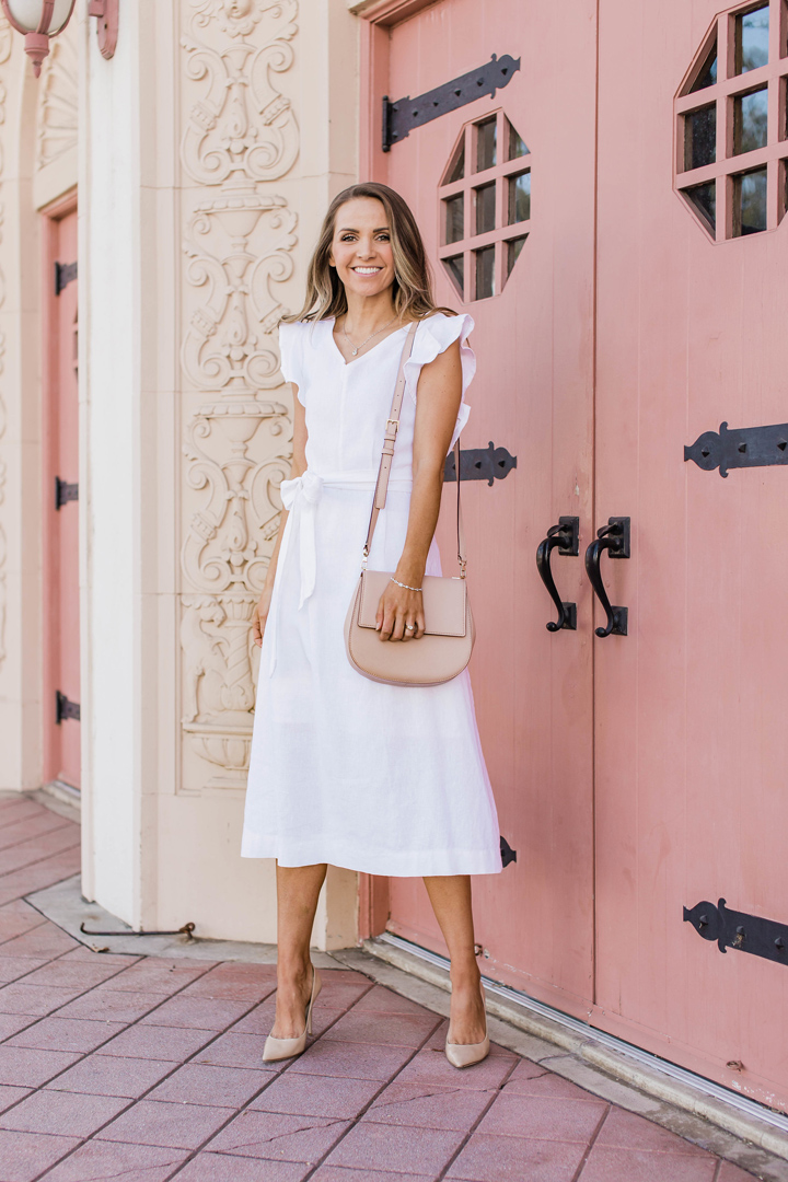 Shane Co Jewelry with a white linen dress