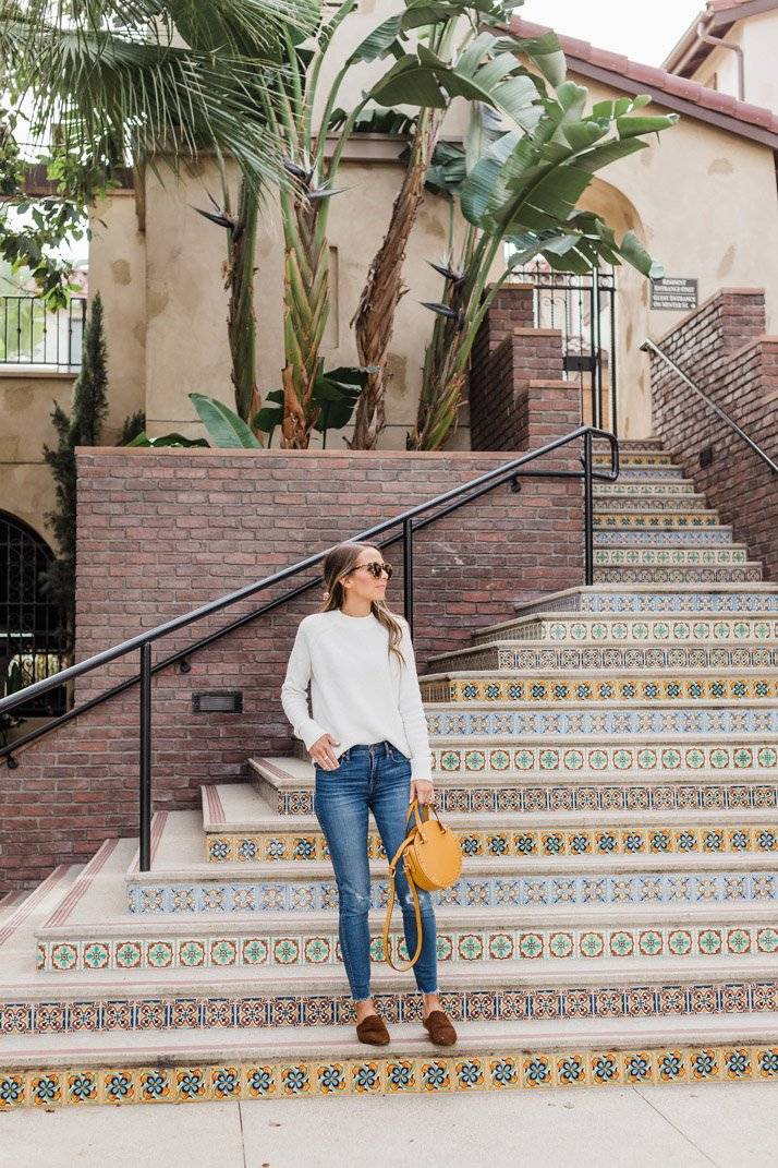 beautiful tiled staircase and a simple white sweater and jeans outfit